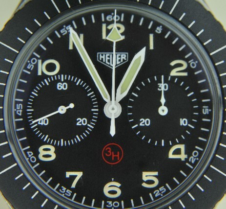Closeup image of a vintage Heuer dial